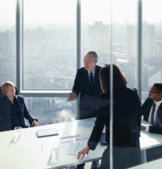 Meeting in modern board room overlooking the skyline